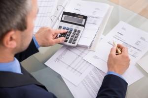Businessman Doing Calculating